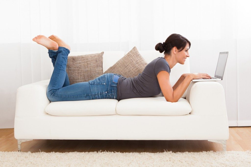 woman-laying-on-couch-with-computer1-1024x682