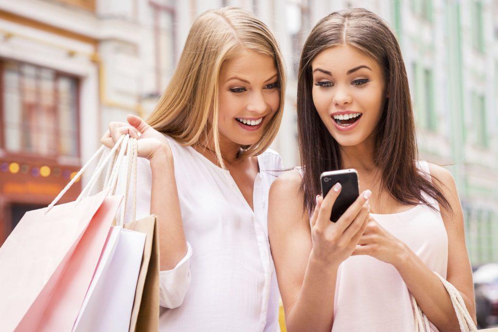 women smiling on phone